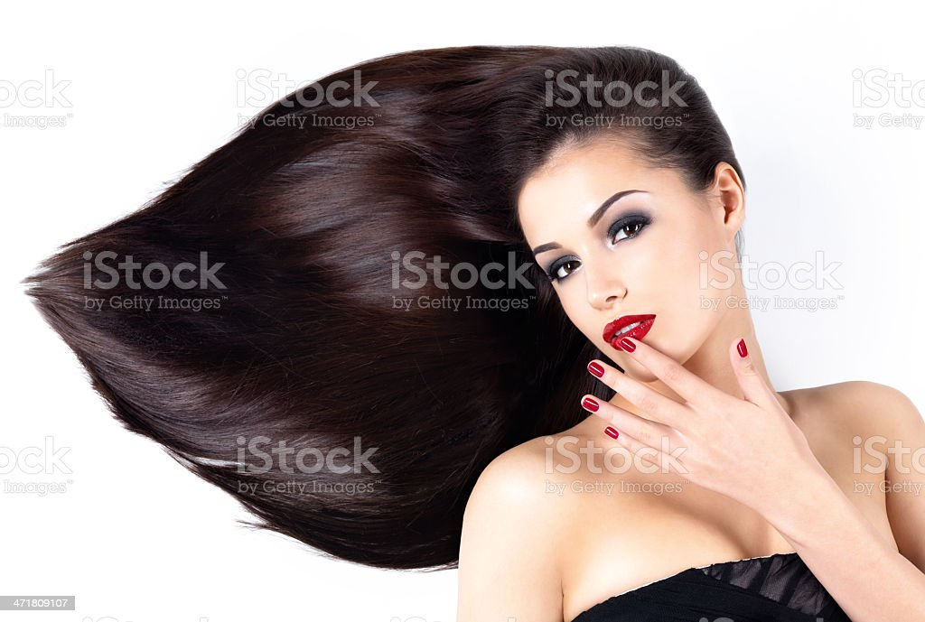 Woman with long straight hairs and elegance nails royalty-free stock photo