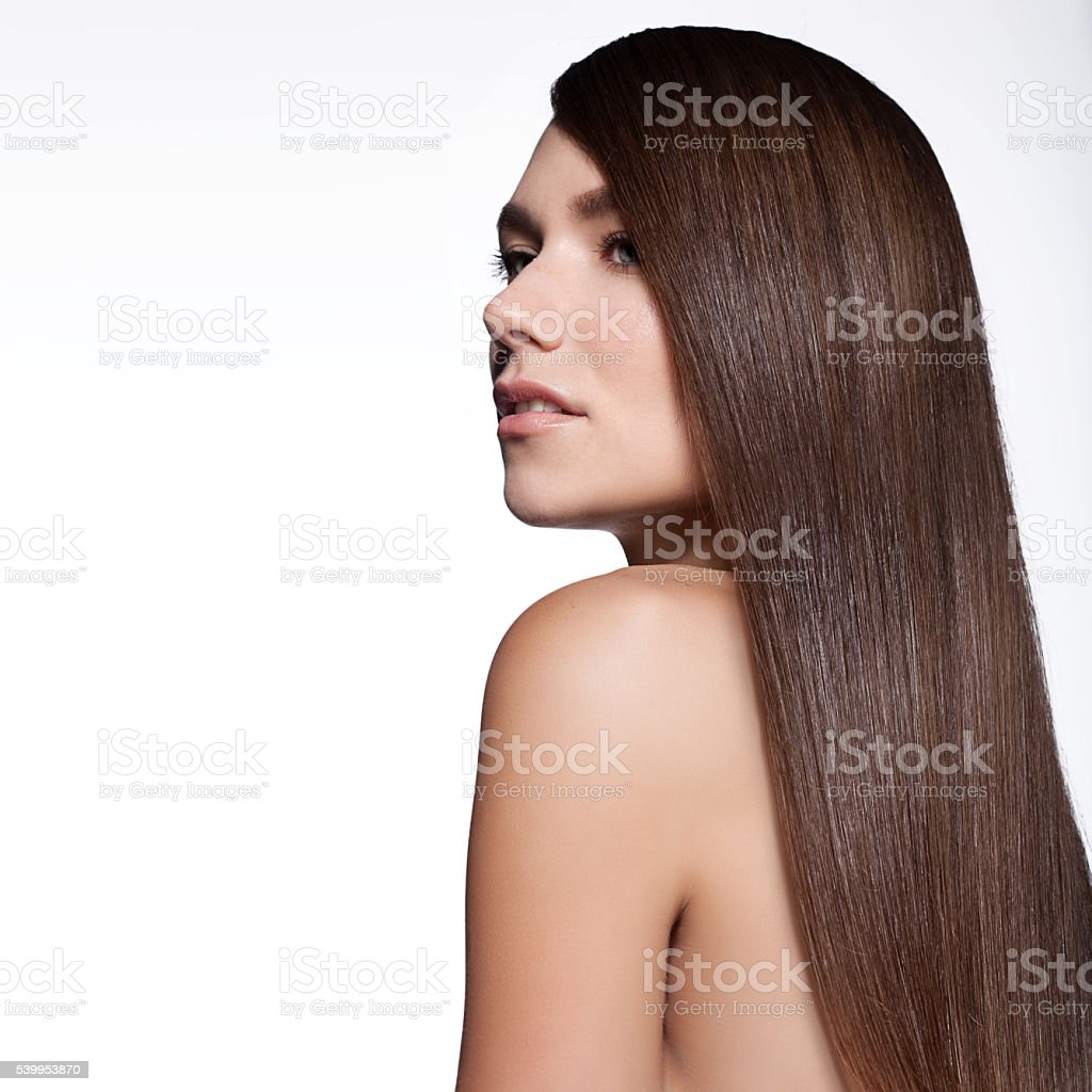 Woman with long thick straight hair stock photo