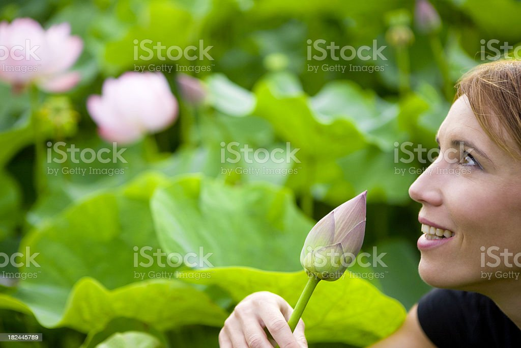 Woman with lotus flower royalty-free stock photo