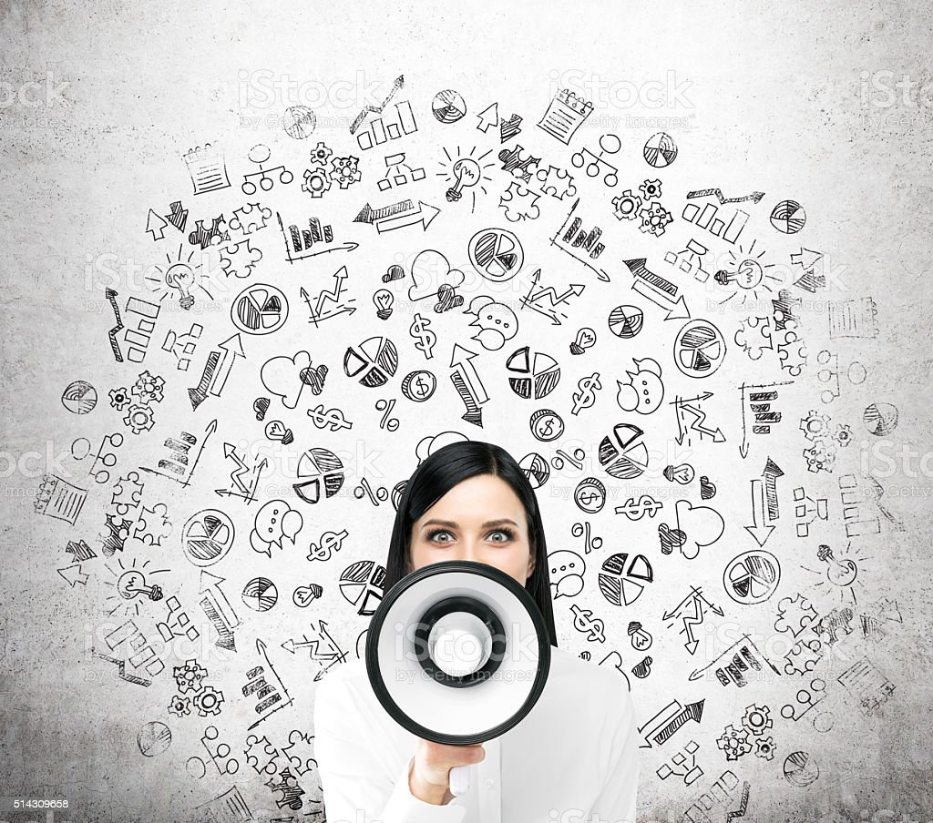 Woman with loudspeaker stock photo