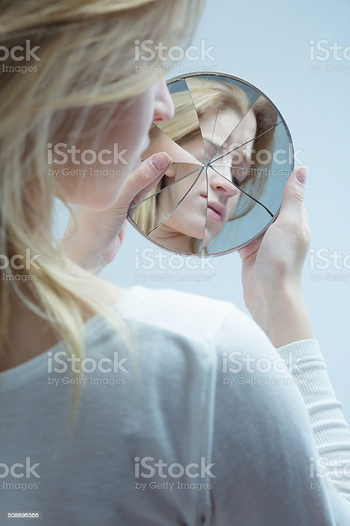 Woman with low self-esteem stock photo