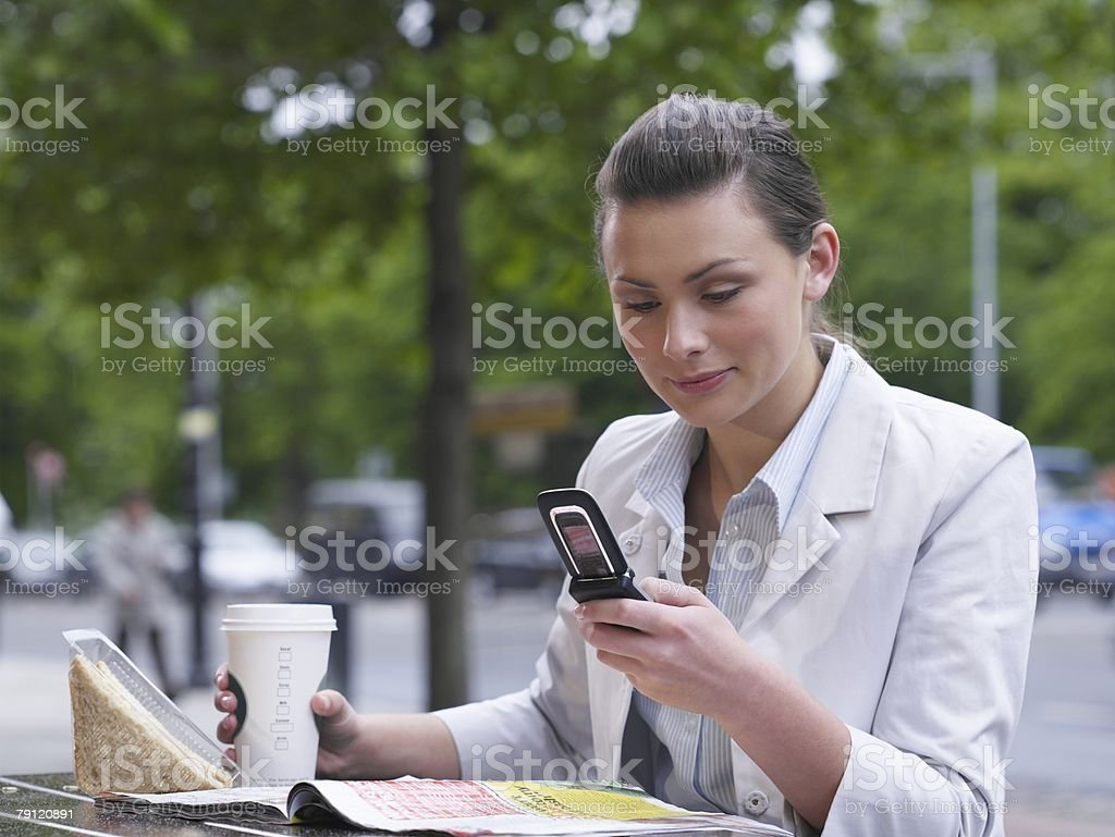 Woman with lunch and cellphone royalty-free stock photo