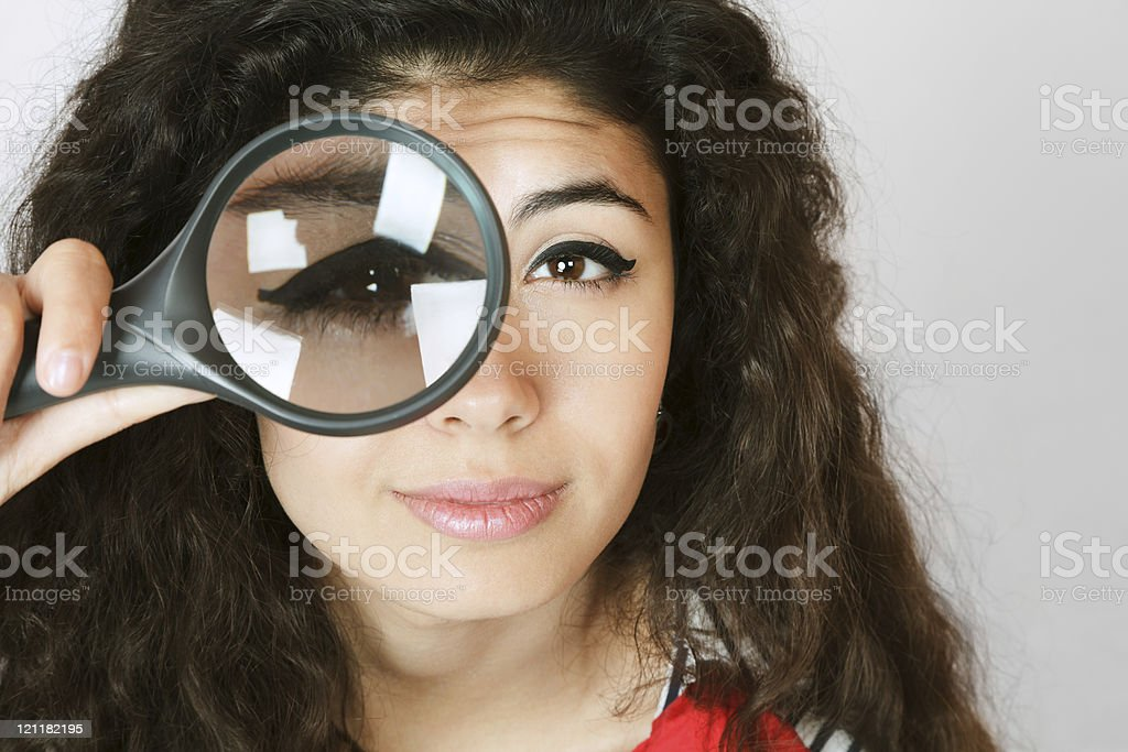Woman with magnifying glass stock photo