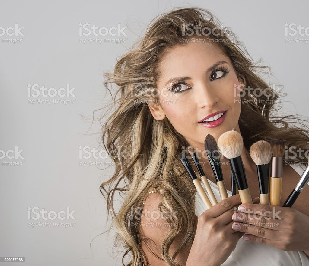 Woman with makeup brushes stock photo