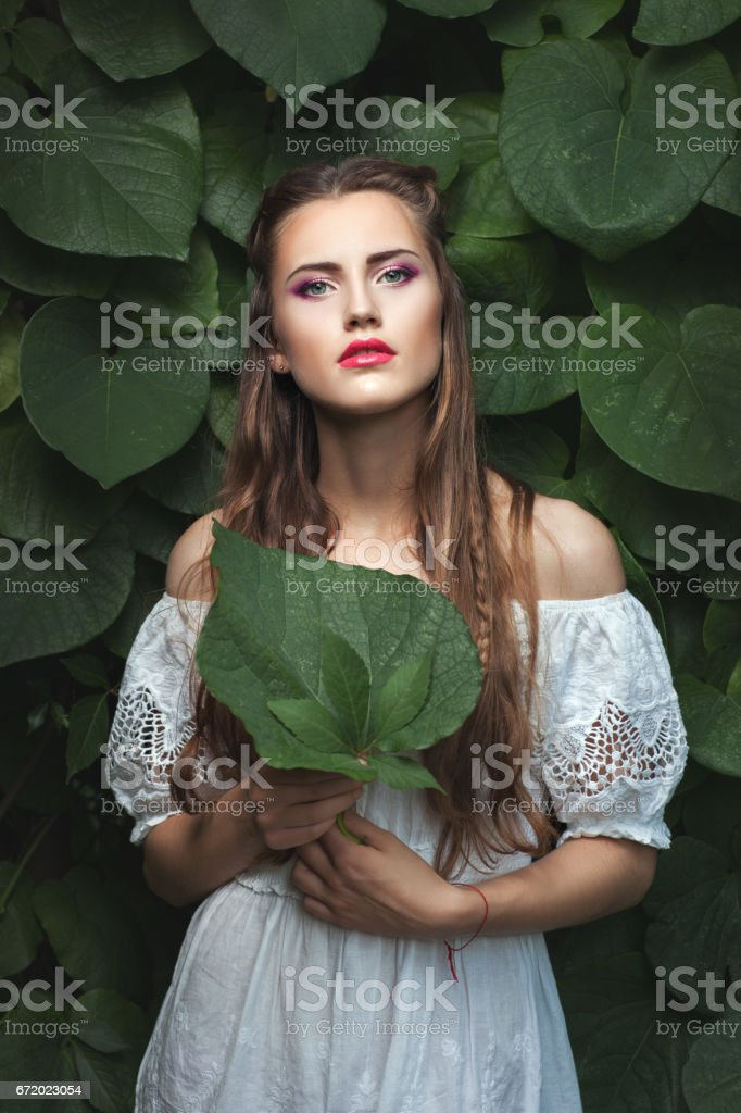Woman with makeup in nature. stock photo