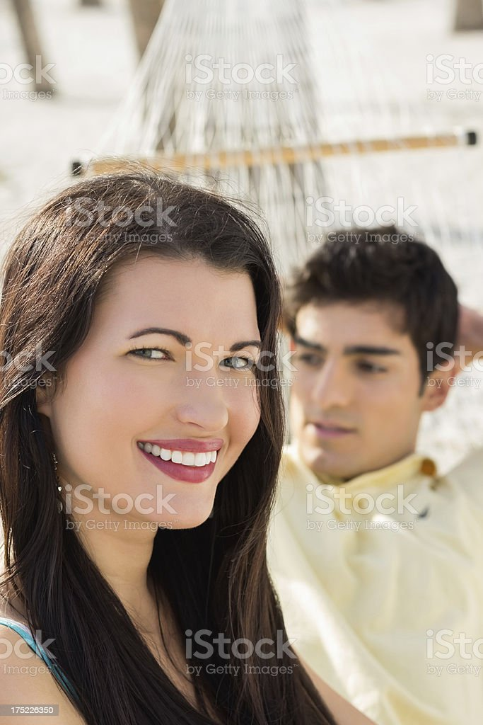 Woman With Man On Hammock At Park. royalty-free stock photo