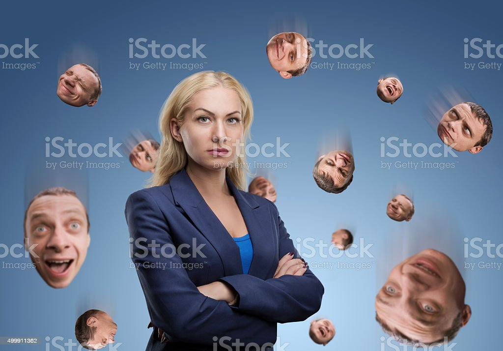 Woman with man's head in the air stock photo
