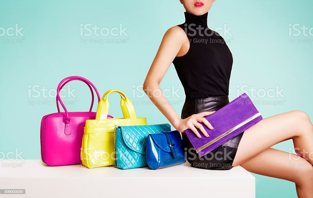 Woman with many colorful bags. stock photo