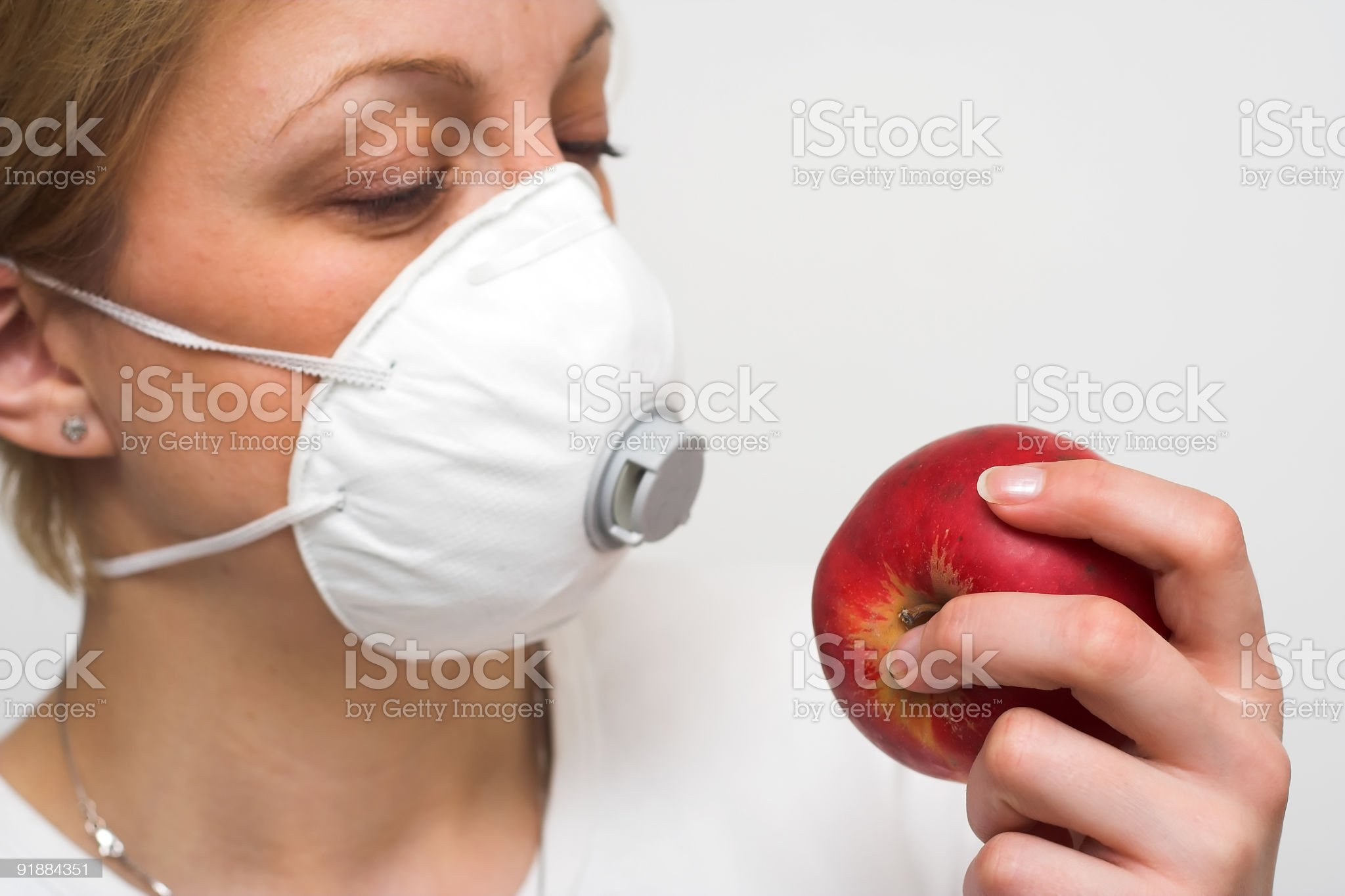 Woman with mask and apple royalty-free stock photo