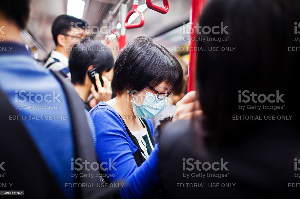 Woman with mask in subway train royalty-free stock photo