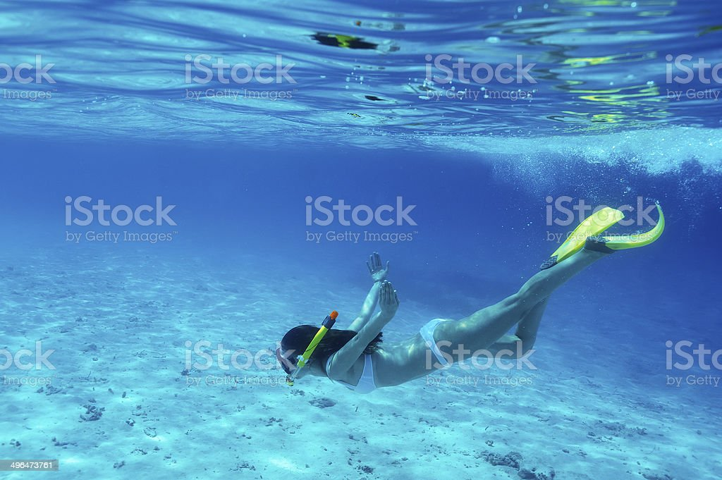 Woman with mask snorkeling stock photo