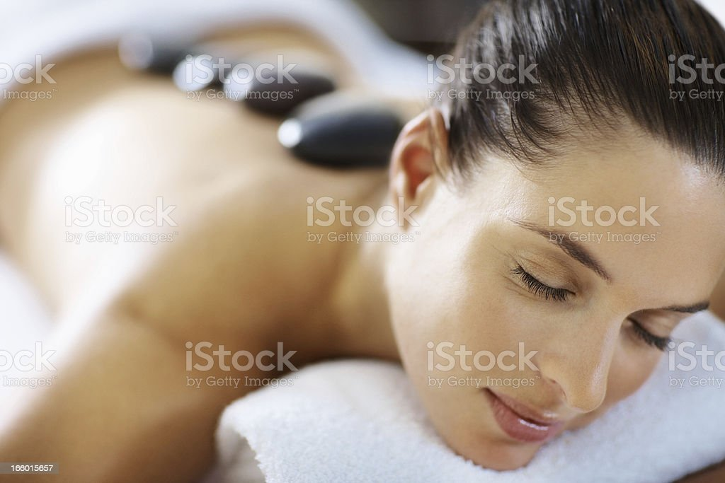 Woman with massage stones royalty-free stock photo