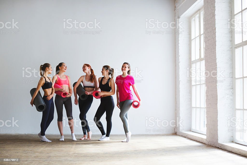 Woman with mats for yoga in the gym. stock photo