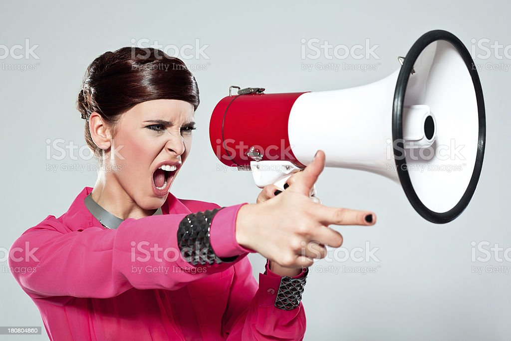 Woman with megaphone royalty-free stock photo