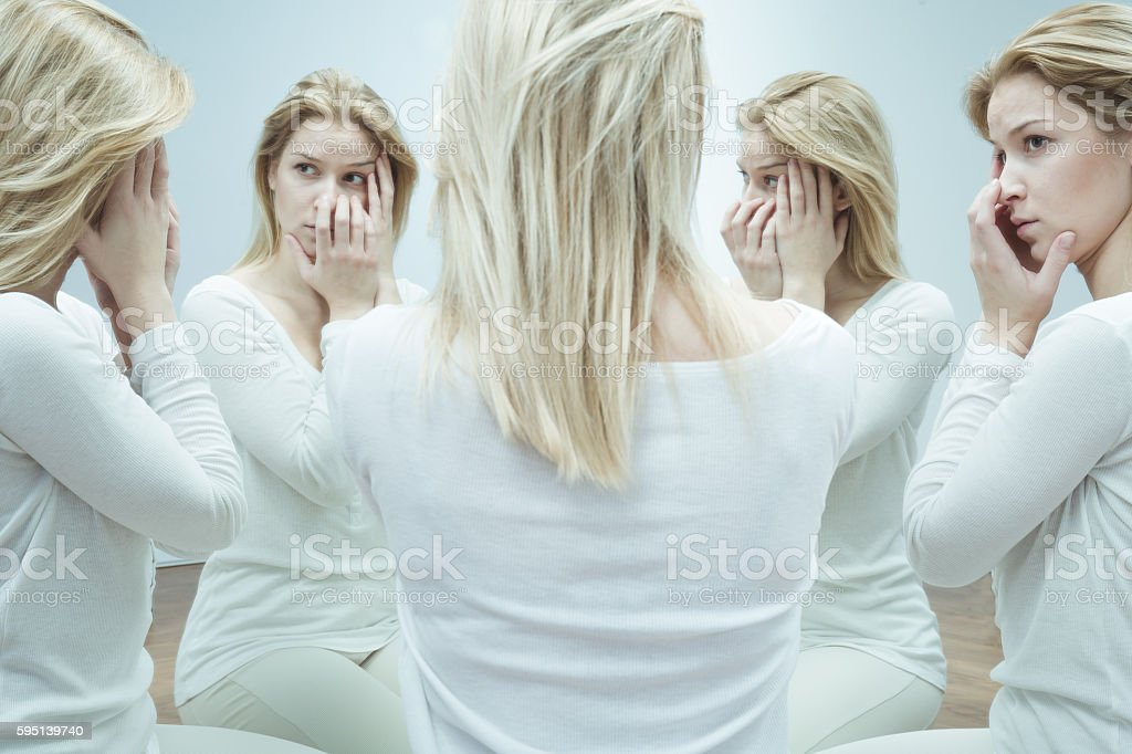 Woman with mental disoreder stock photo