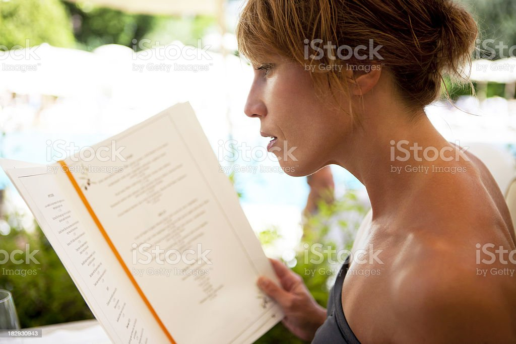 Woman with menu royalty-free stock photo