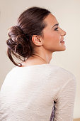 woman with messy lower bun