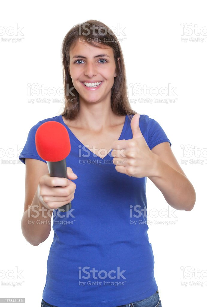 Woman with microphone showing thumb up stock photo