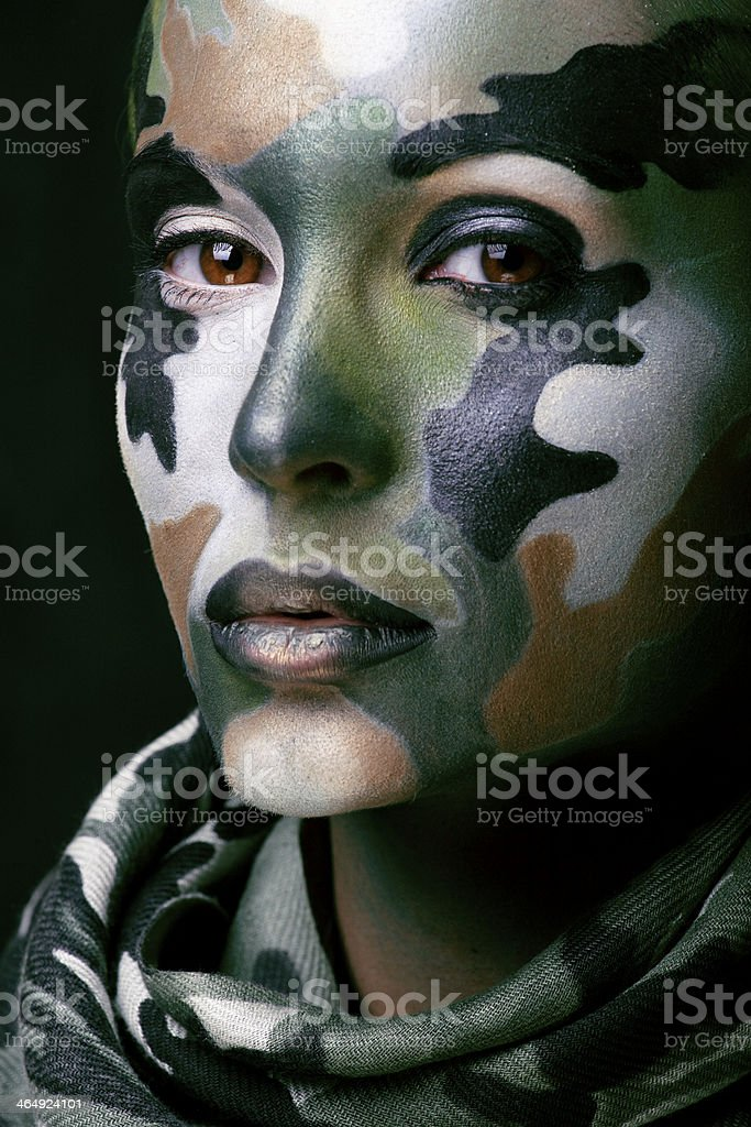 woman with military style clothing and face paint make-up stock photo