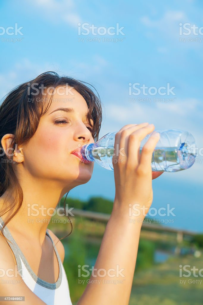 Woman With Mineral Water stock photo