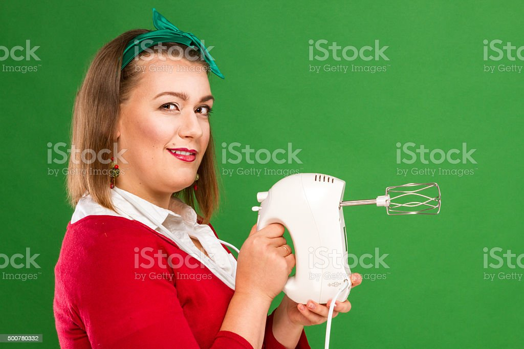 Woman with mixer royalty-free stock photo