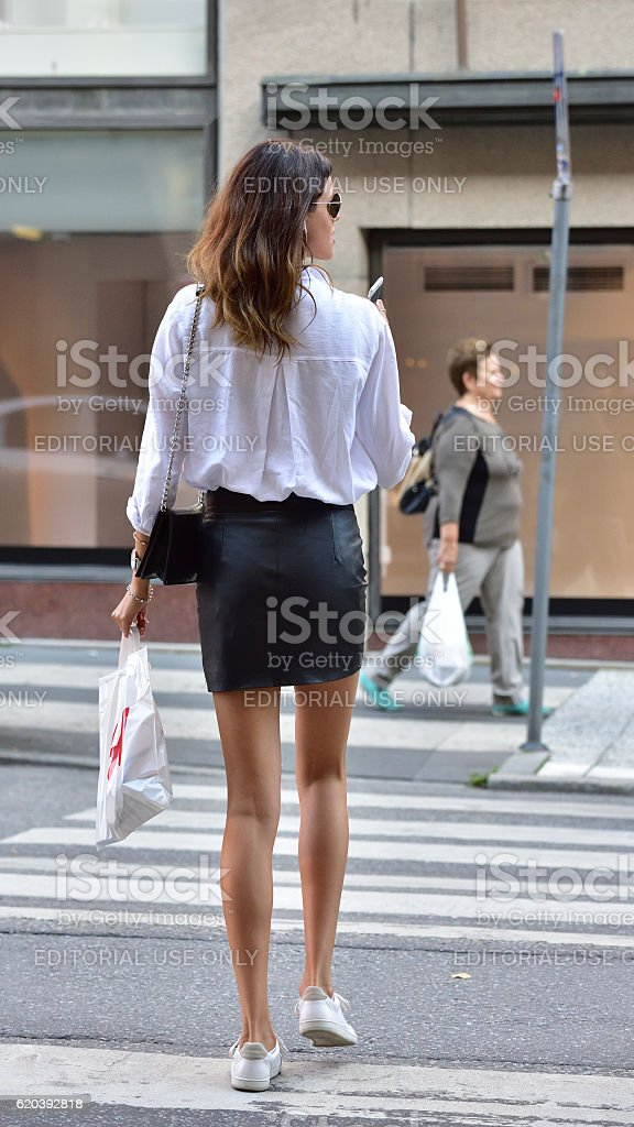 Woman with mobile phone and shopping bag stock photo