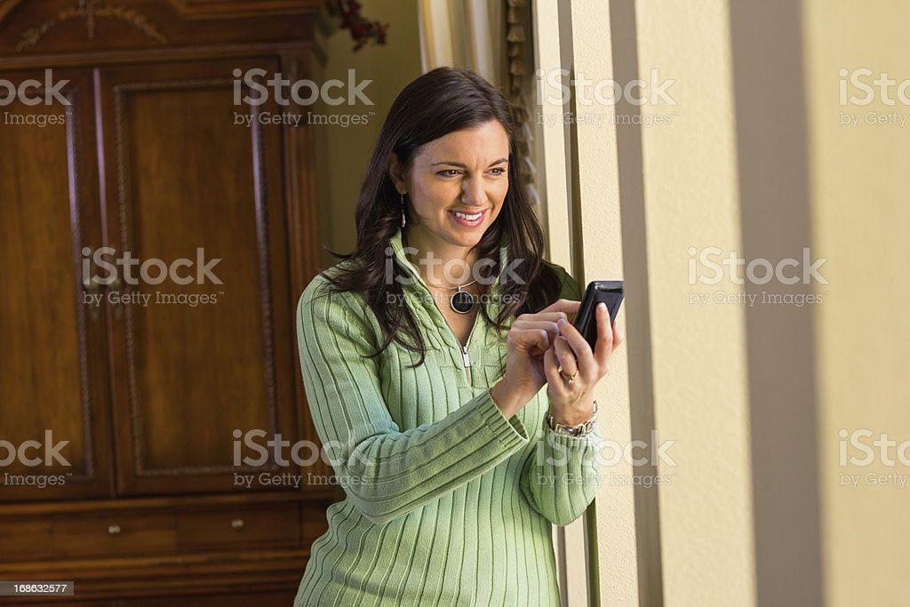 Woman With Mobile Phone Looking Away royalty-free stock photo
