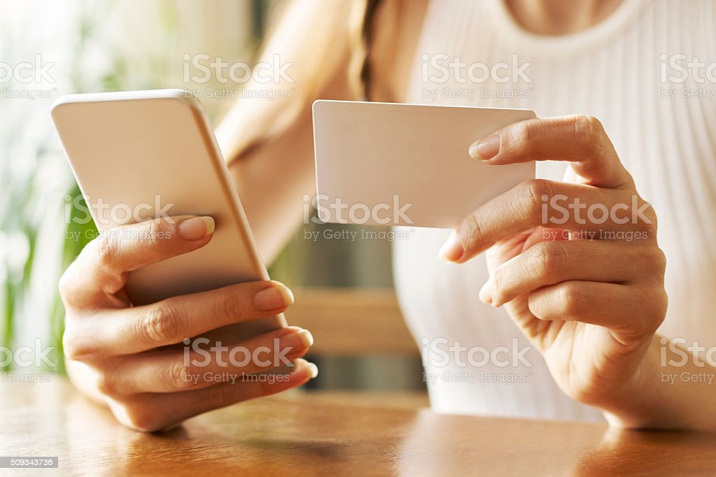 Woman with Mobile Phone Shopping Online stock photo