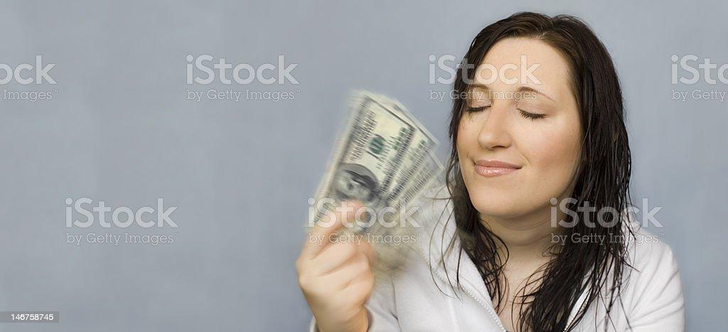 Femme avec de l'argent fan dreaming photo libre de droits