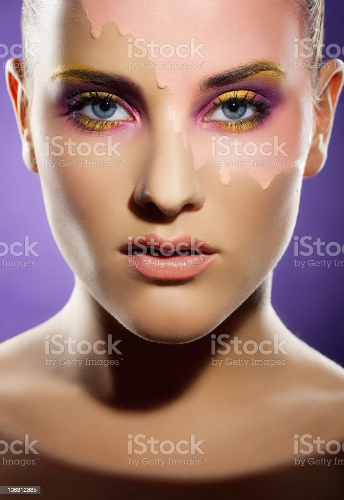 woman with multicolored makeup stock photo