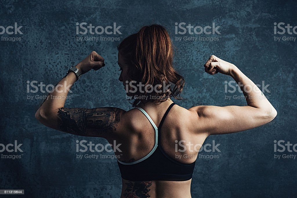 Woman with muscular back in training clothing stock photo