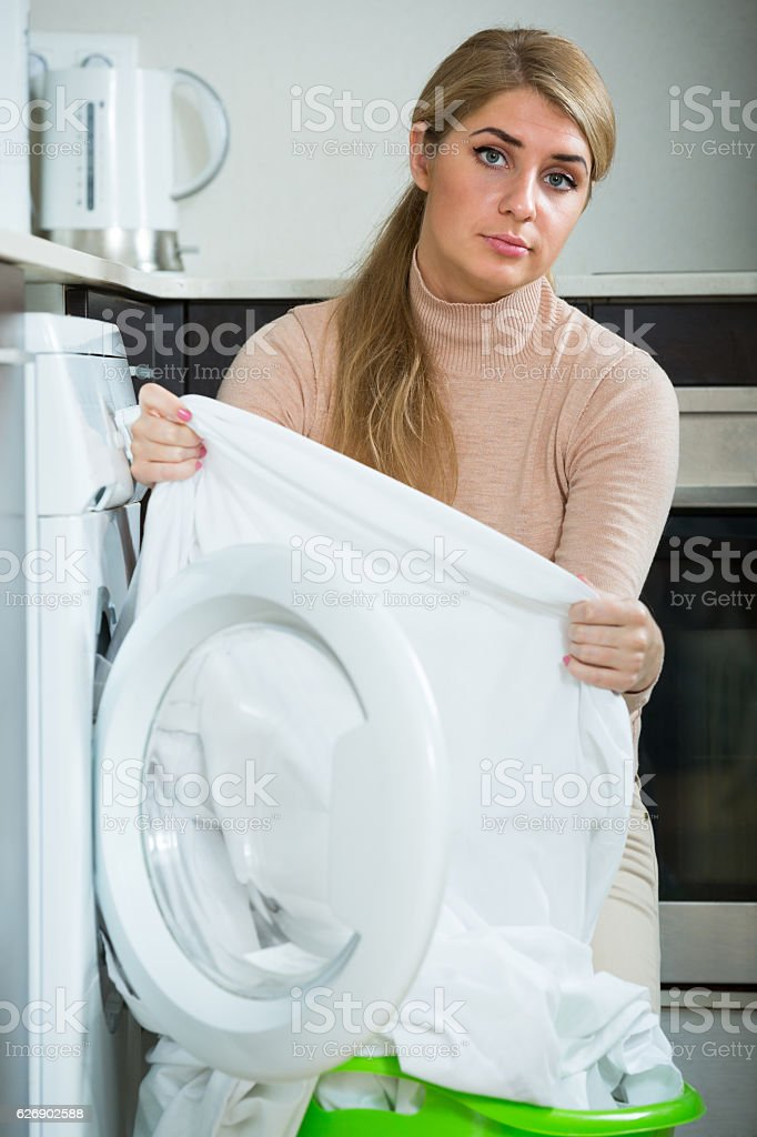 woman with musty linen after laundry stock photo