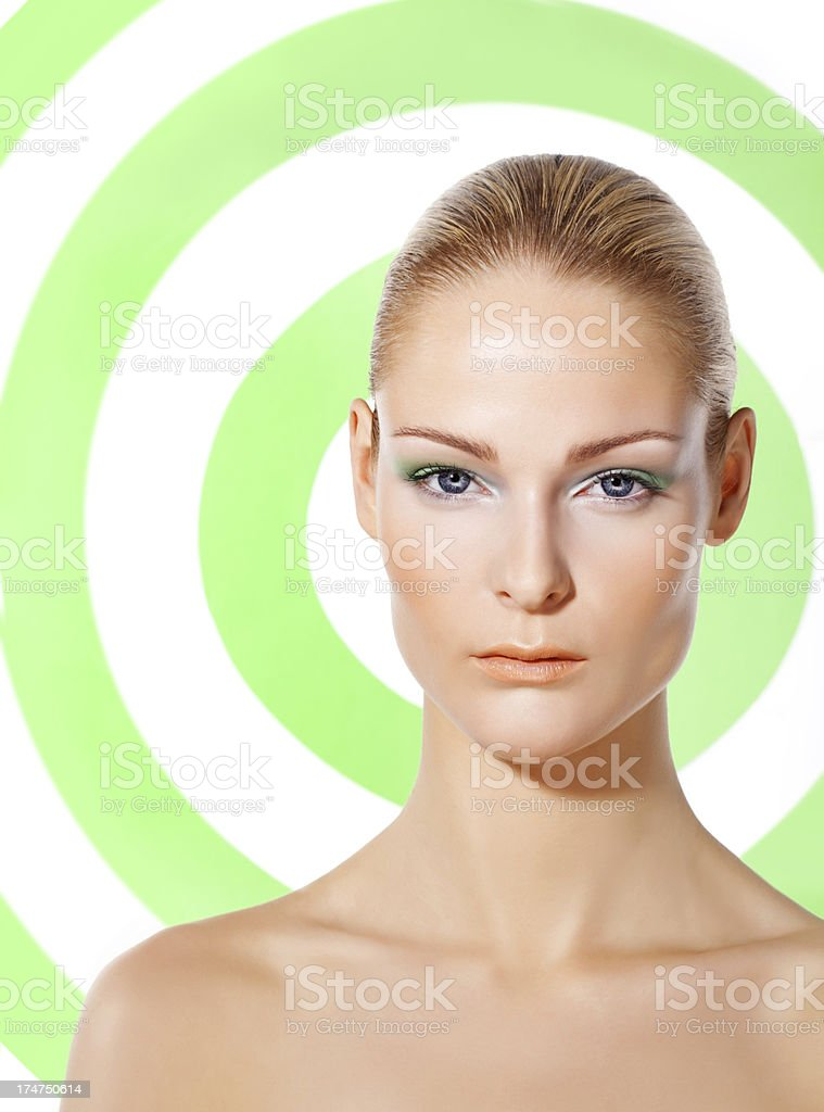 woman with natural make-up against green circles background royalty-free stock photo