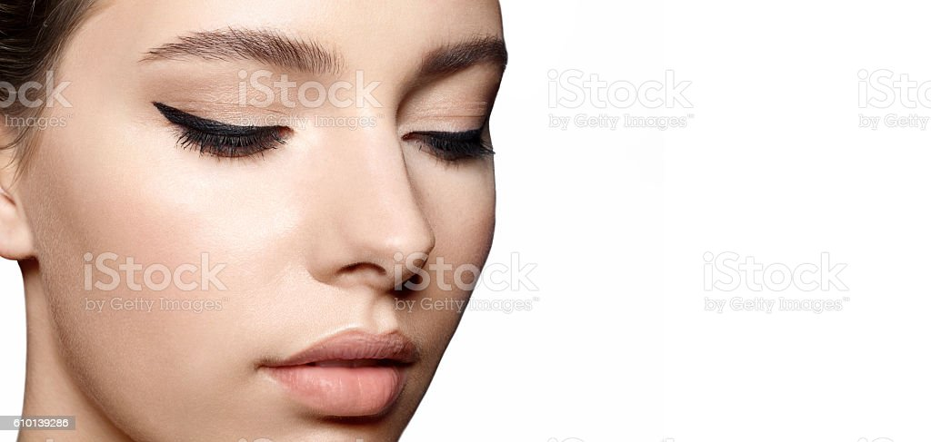 Woman with natural make-up and  black arrows on the eyes stock photo