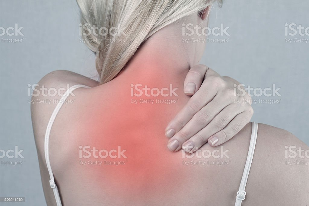 Woman with neck and back pain. Pain relief concept stock photo