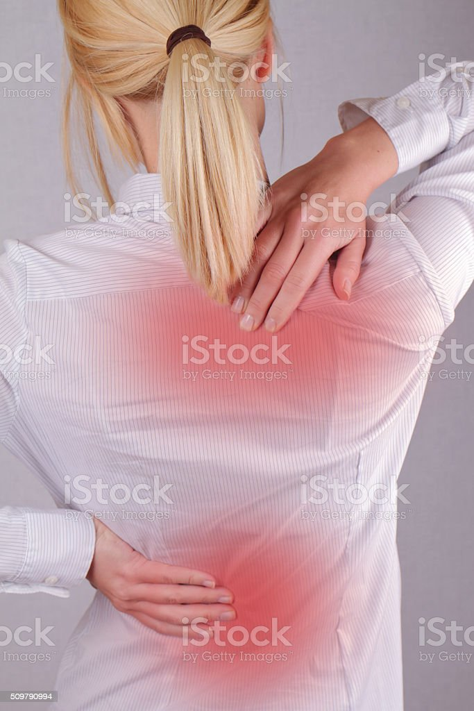 Woman with neck / back pain. stock photo
