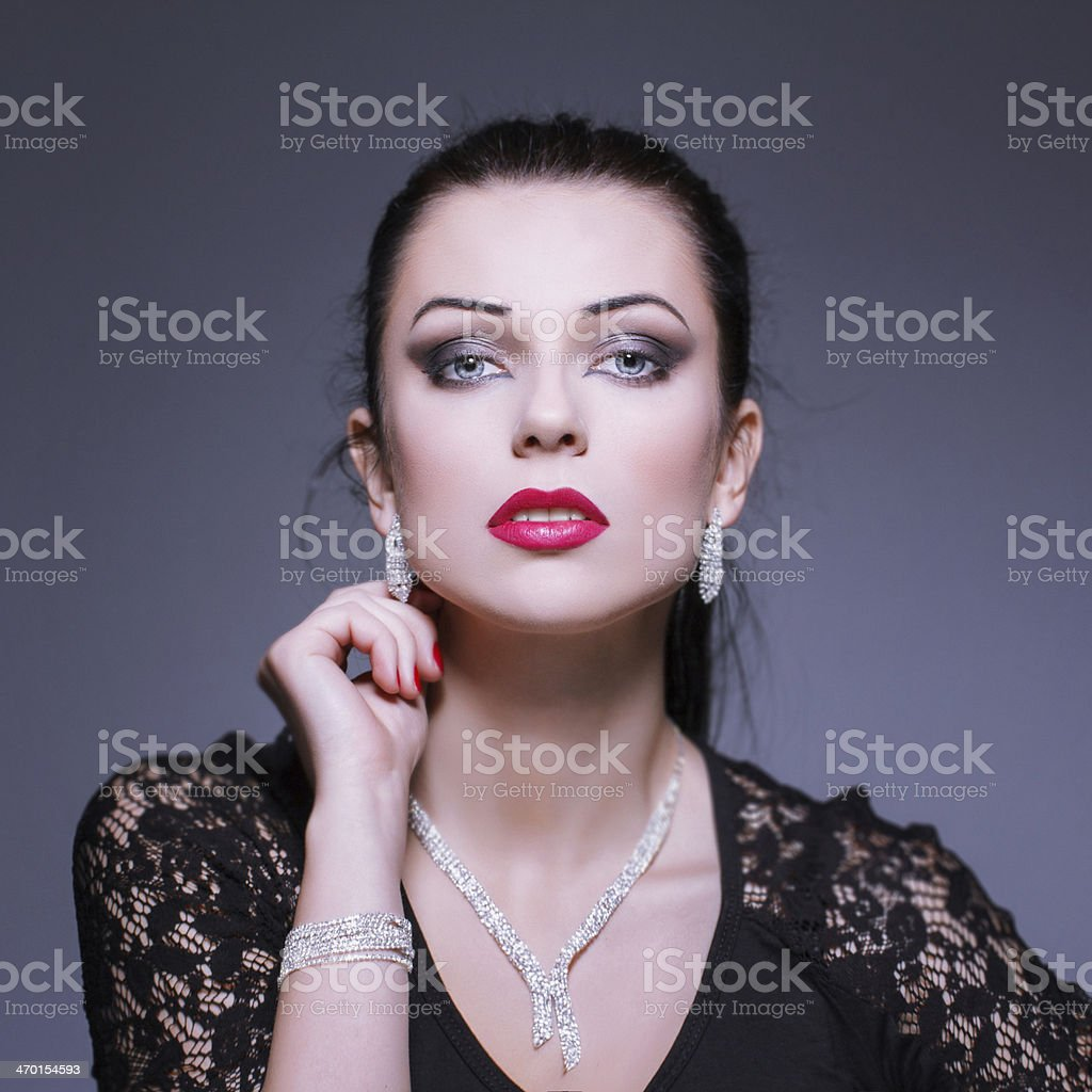Woman with necklace and earrings royalty-free stock photo