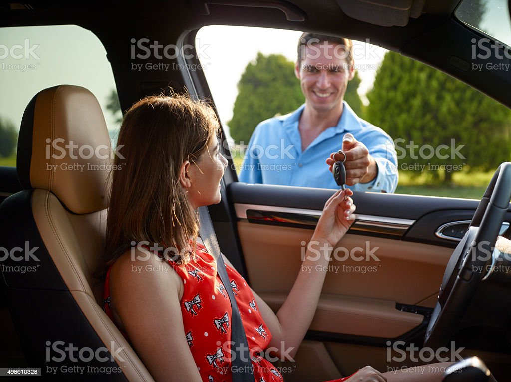 Woman with new car keys stock photo