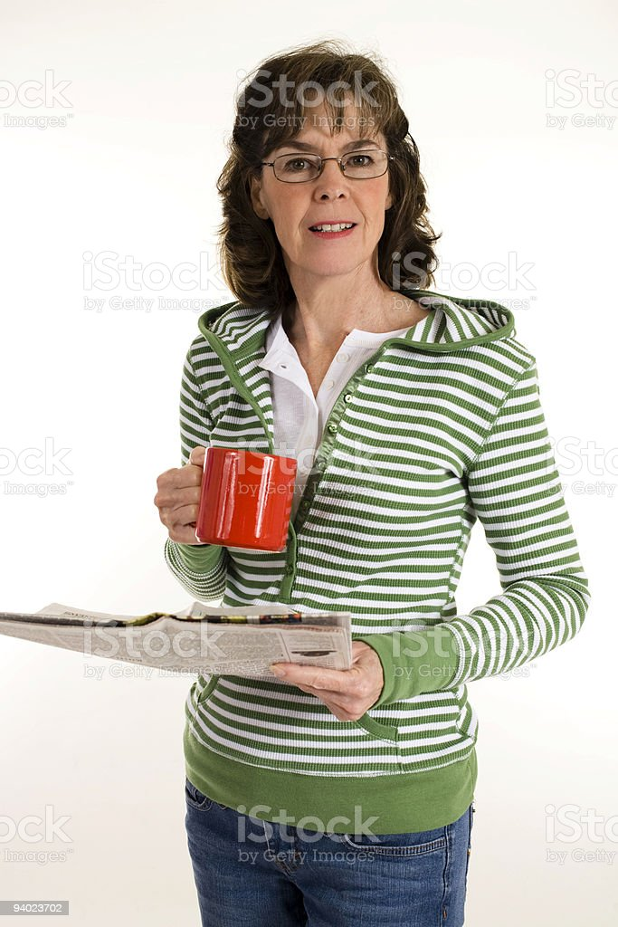 Woman with newspaper and coffee royalty-free stock photo