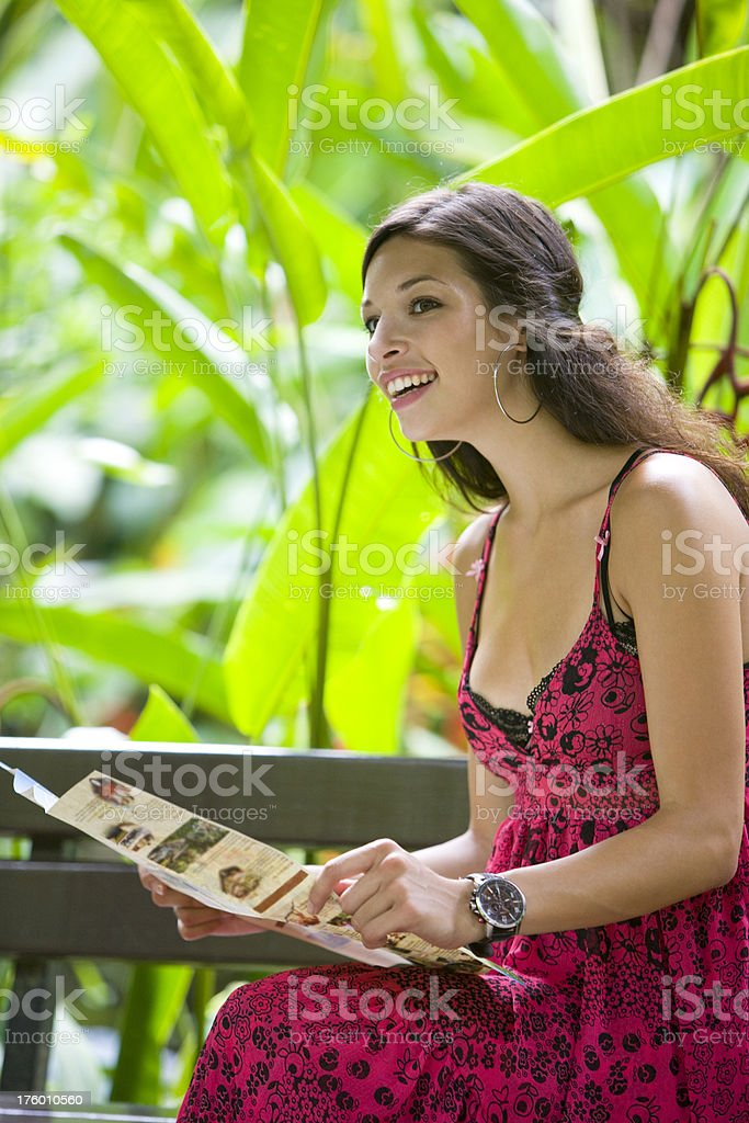 Woman with newspaper royalty-free stock photo