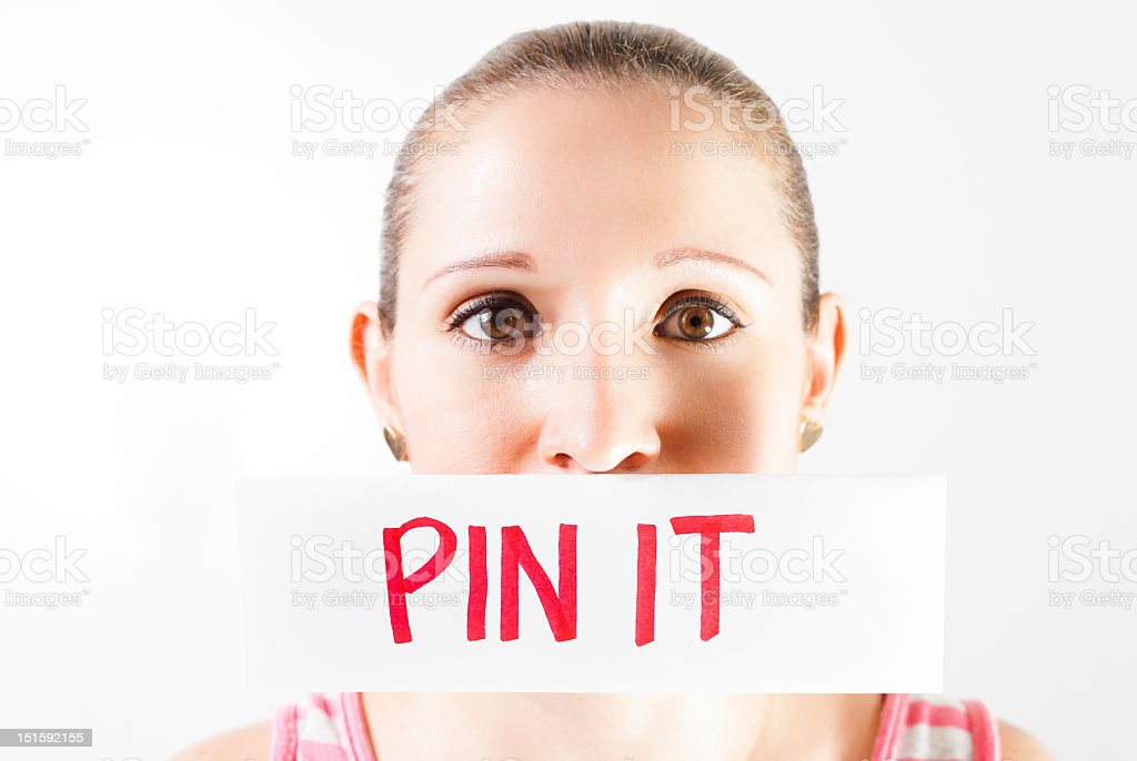 Woman with note pin it royalty-free stock photo