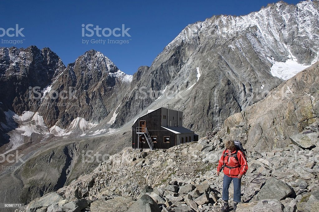 Woman with on the background mountain refuge Nacamuli (Italy) royalty-free stock photo