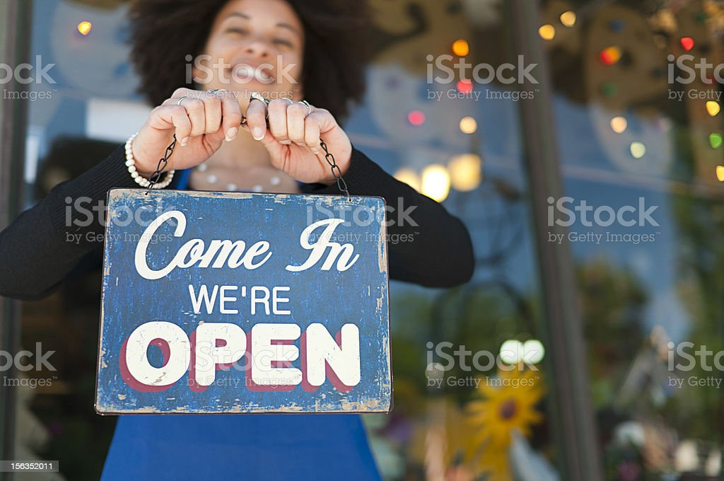 Woman with Open Sign stock photo