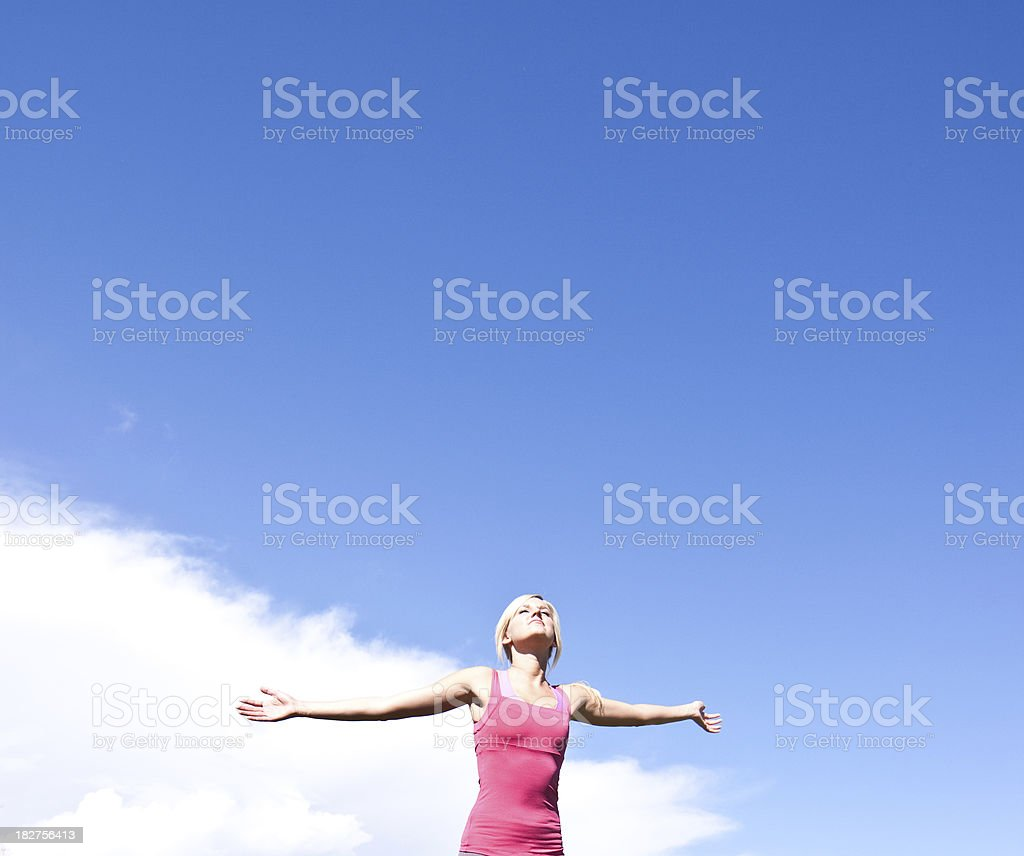 Woman with out stretched arms royalty-free stock photo