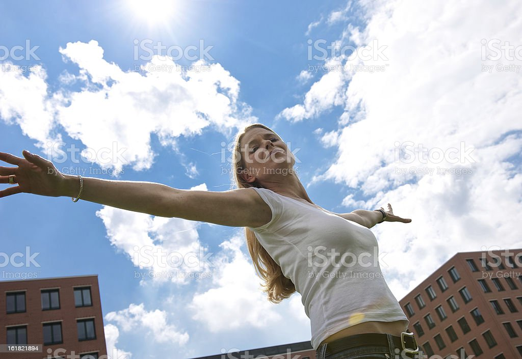 Woman with outstretched arms stock photo