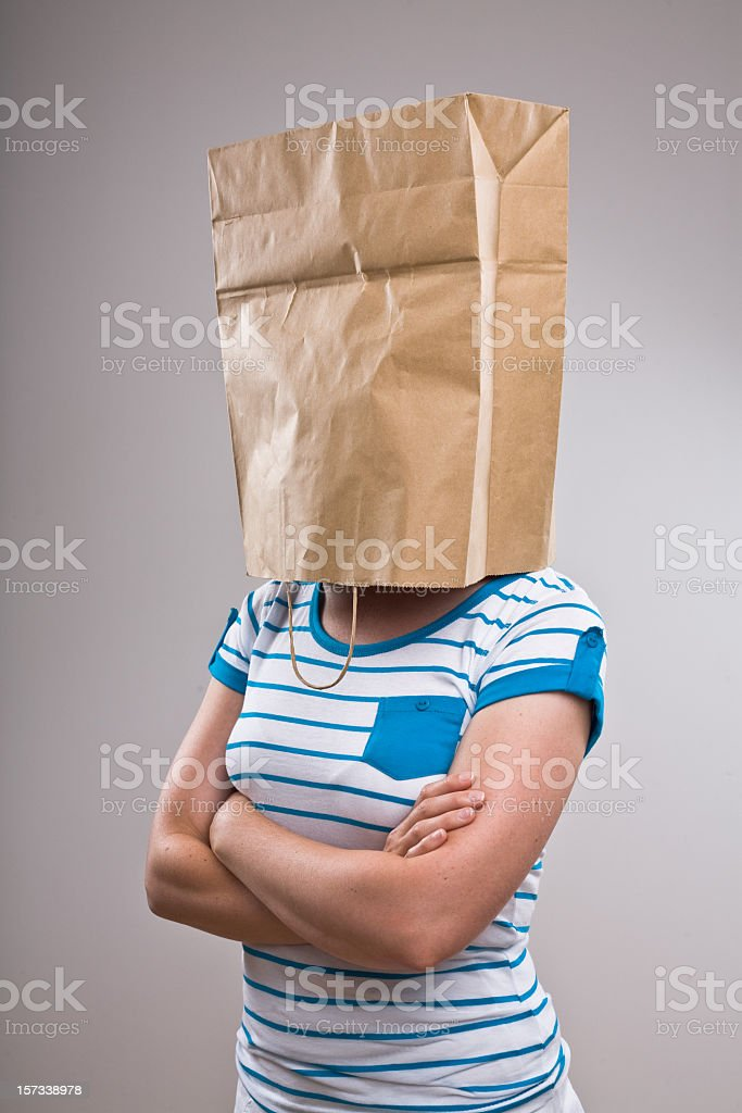 Woman with paper bag on her head royalty-free stock photo