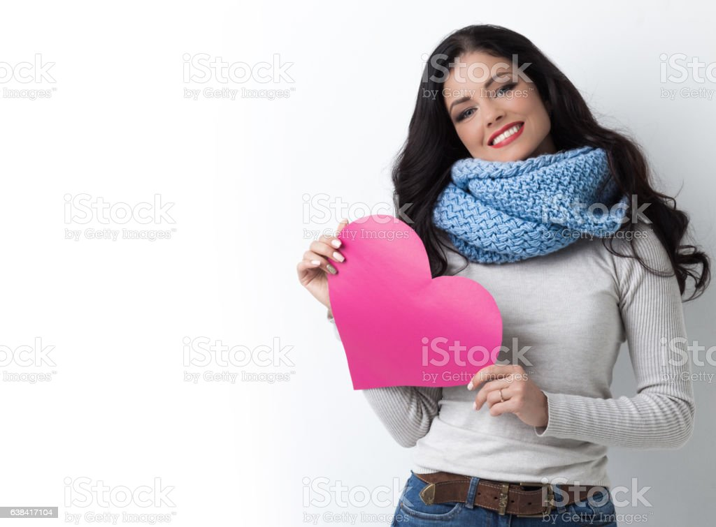 Woman with paper heart stock photo