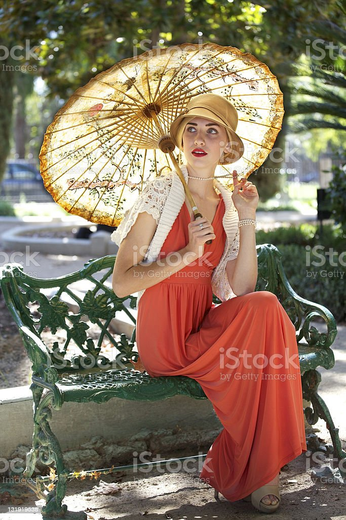 Woman with parasol stock photo