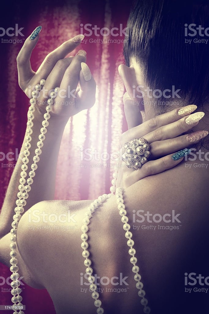 Woman with pearls royalty-free stock photo
