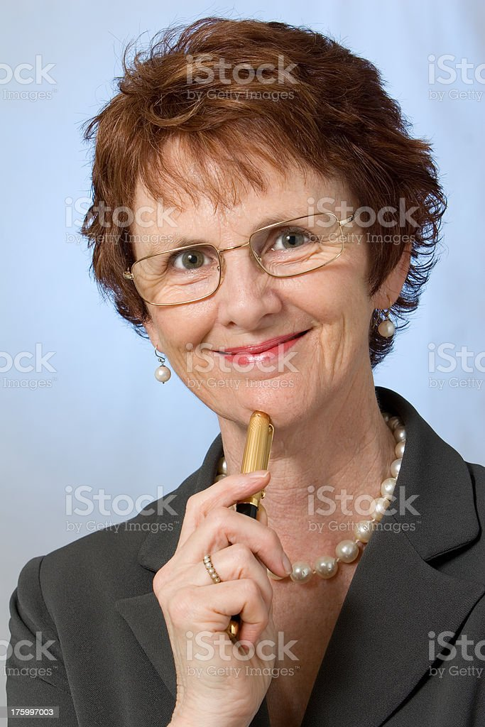 Woman with pen royalty-free stock photo